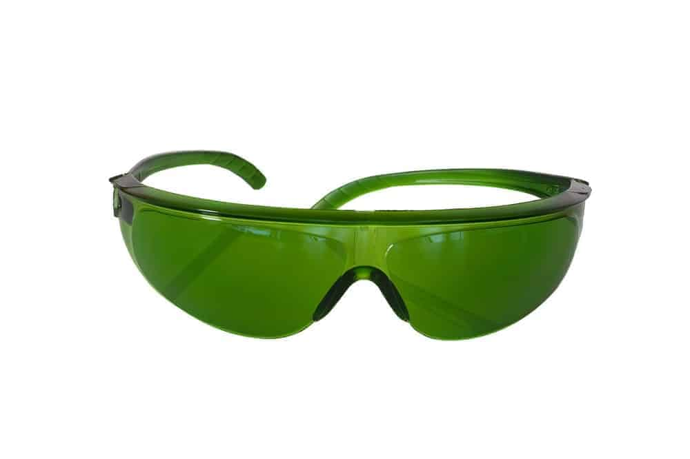 Green-colored safety glasses on a white backdrop.