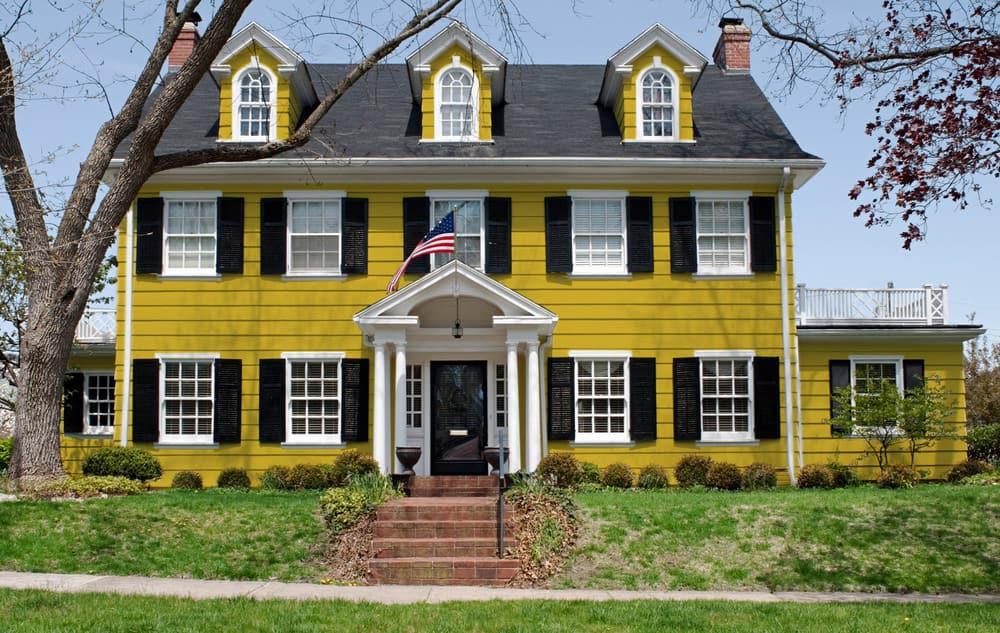 Mustard yellow house exterior - Pantone 117
