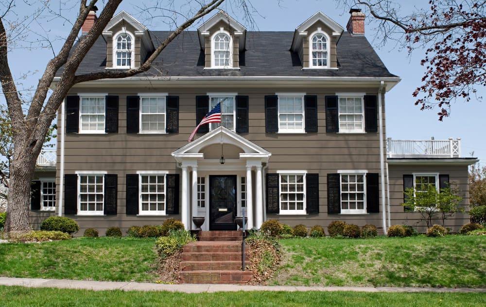 Dark beige house exterior color example - Pantone 404