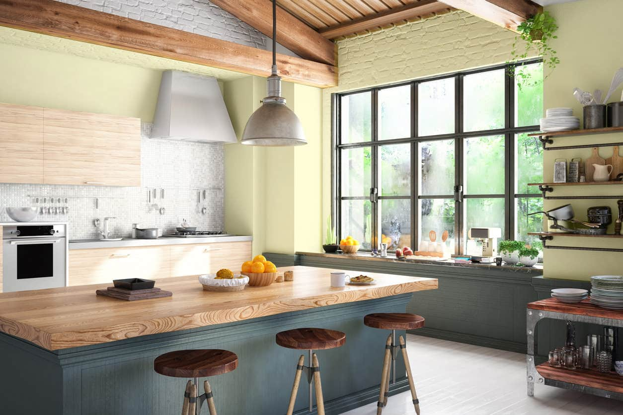 Loft kitchen with yellow walls