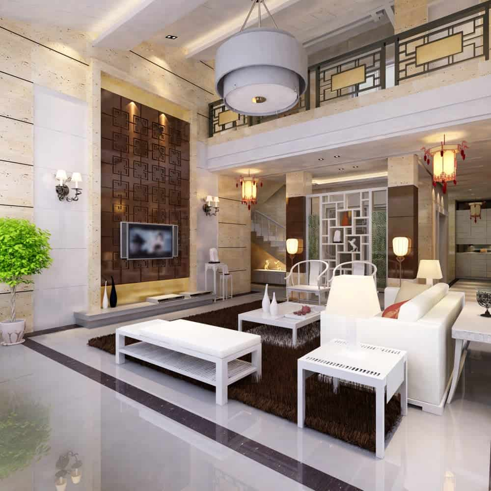 This bright high-ceilinged living room is adorned with dramatic oriental elements fit for an emperor with its beautiful lanterns and a patterned brass wall panel that supports the mounted TV. This is paired with the elegant white sofa set with a furry brown area rug over the white marble flooring.