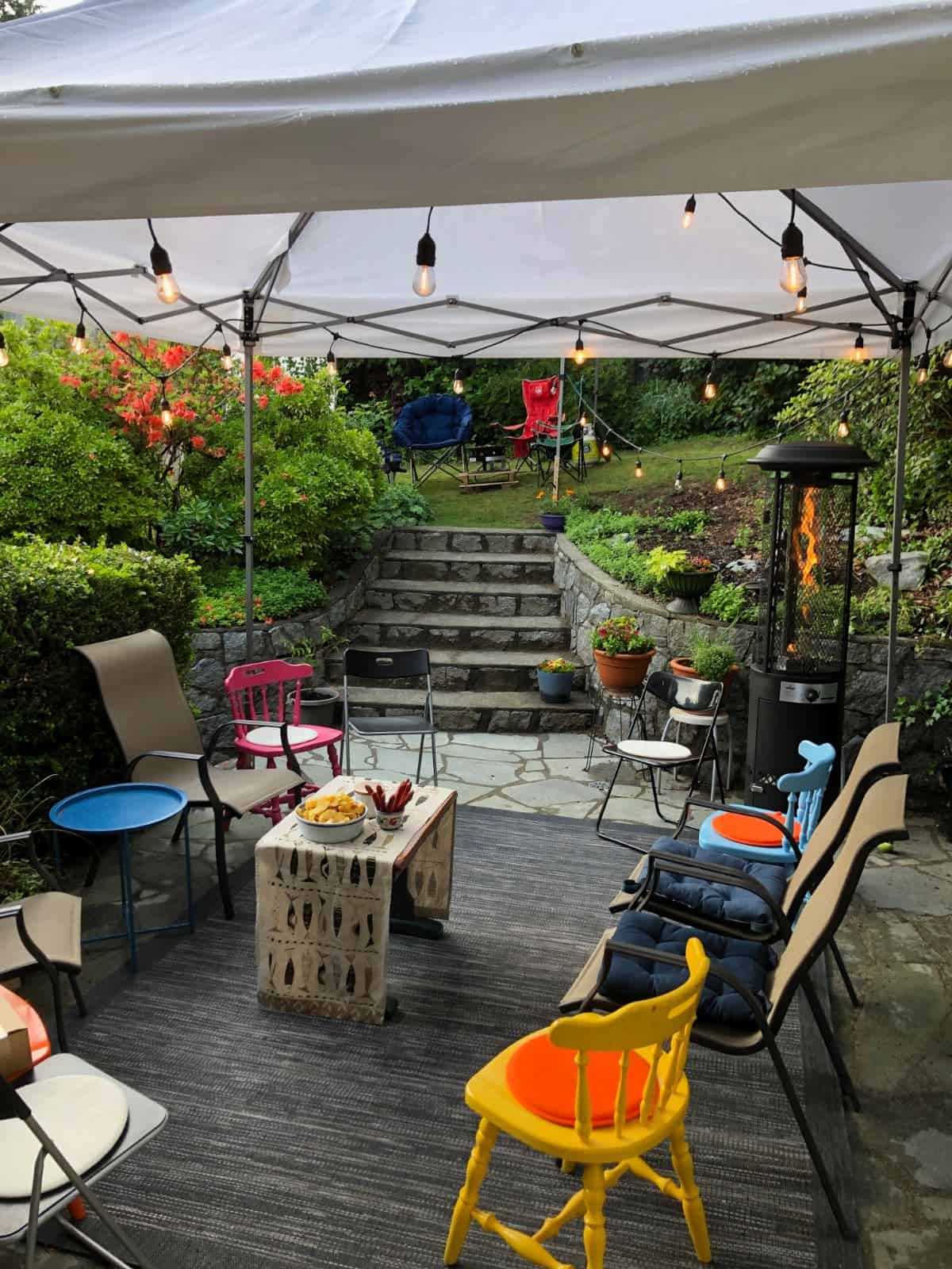 Party patio with tent canopy, string lights and patio heater