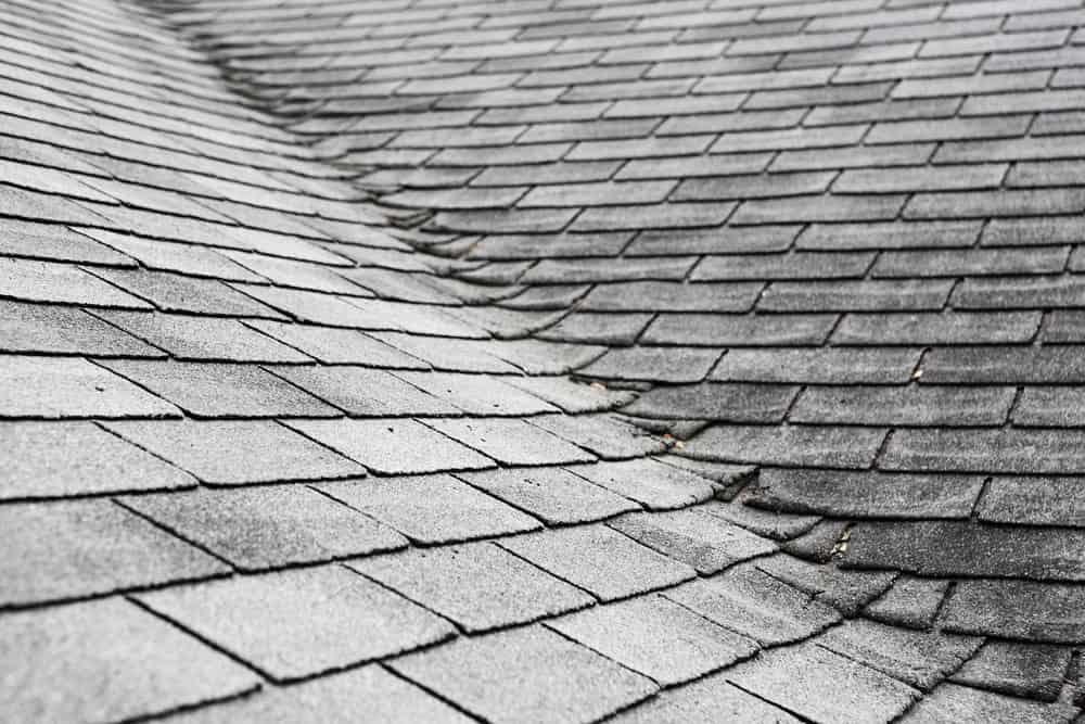Photo of damaged roof valley flashing