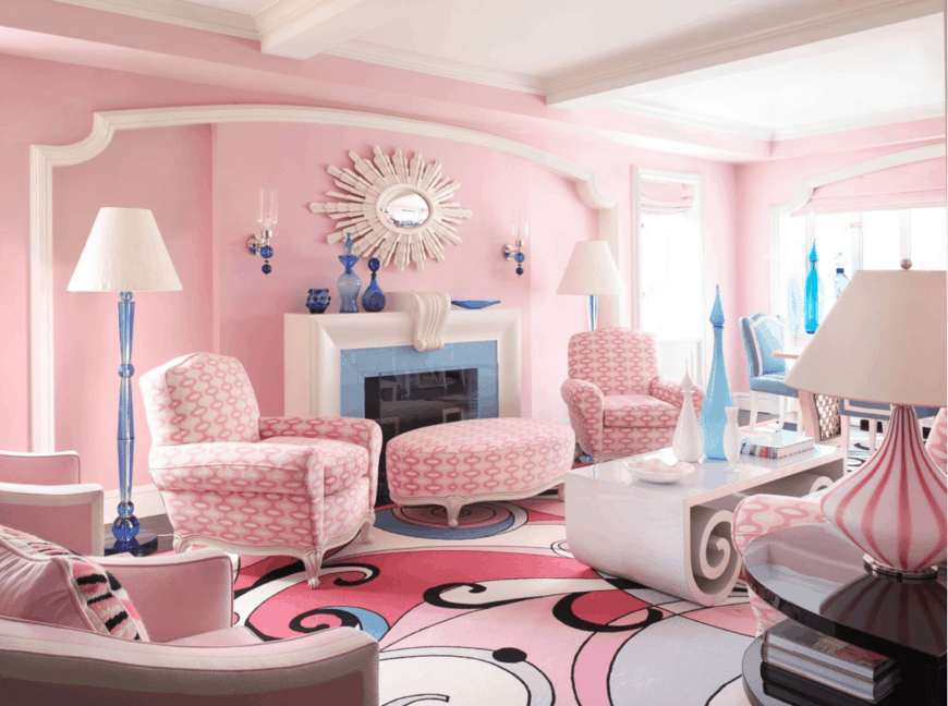 An attractive living room with a burst of cuteness due to its all pink design. It features an eye-catching swirl area rug and a white fireplace.