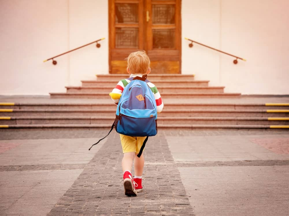 A child going to school with a bag pack
