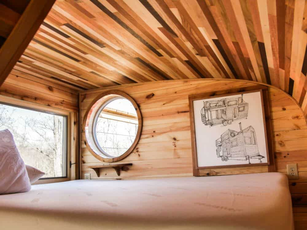 The above tiny house with an observatory-style bedroom loft