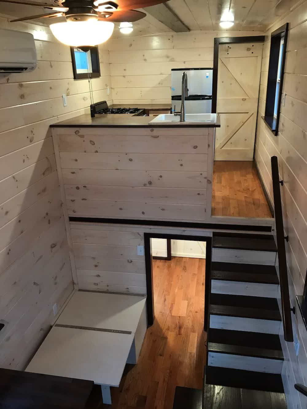 Tiny house with kitchen in loft