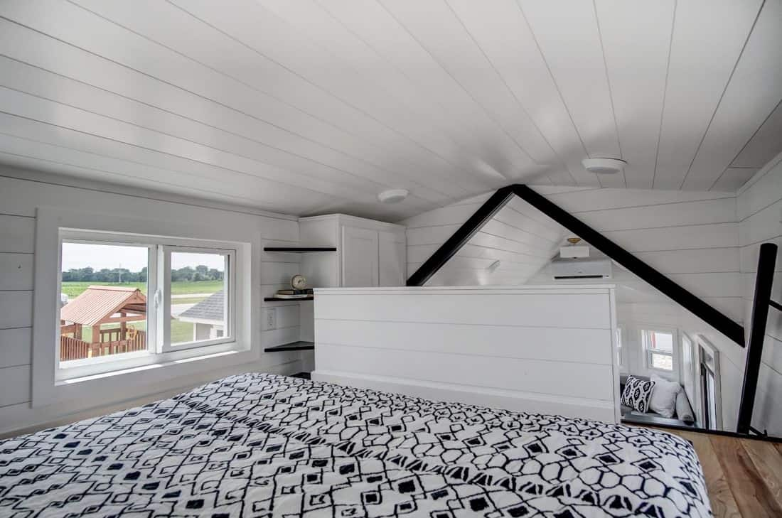 View of foot of bed in tiny house