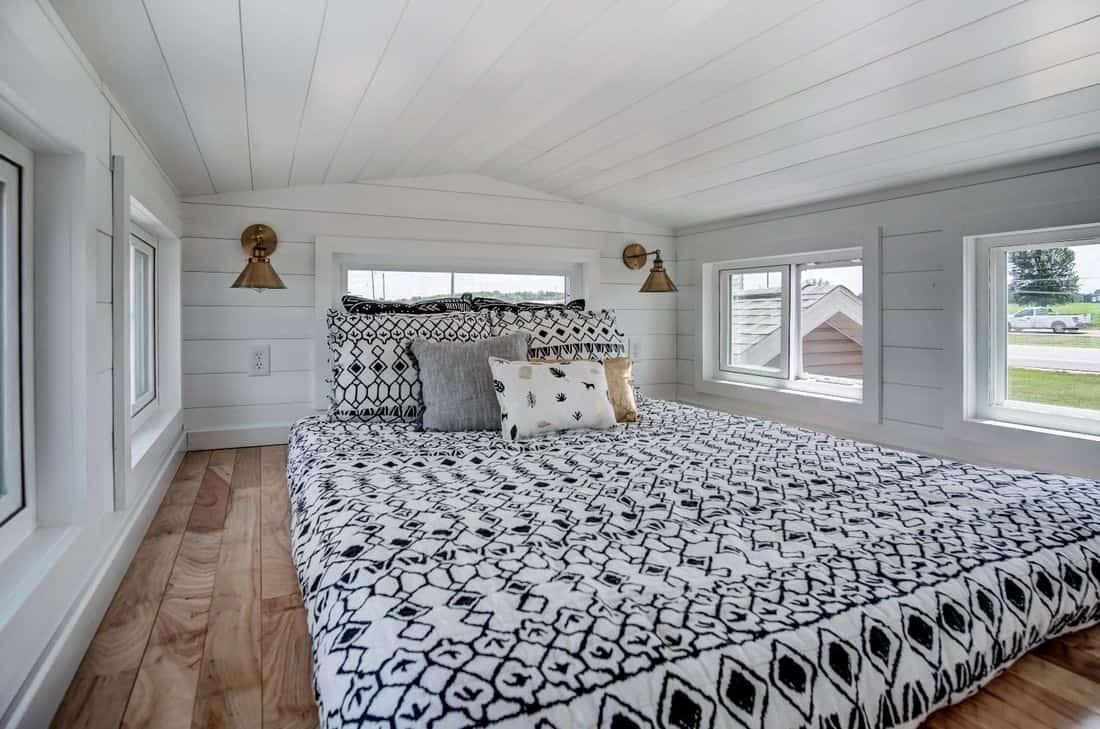 White comfortable tiny home loft