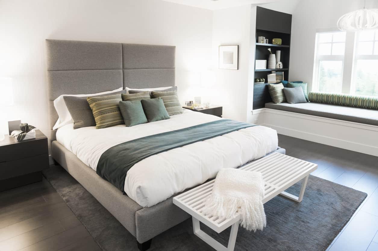 White primary bedroom with window nook