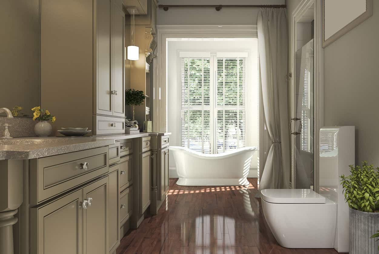 Very cool soaking freestanding tub in a room off the main bathroom with a large curtain screen. The alcove tub area includes double doors with large glass windows overlooking the property.