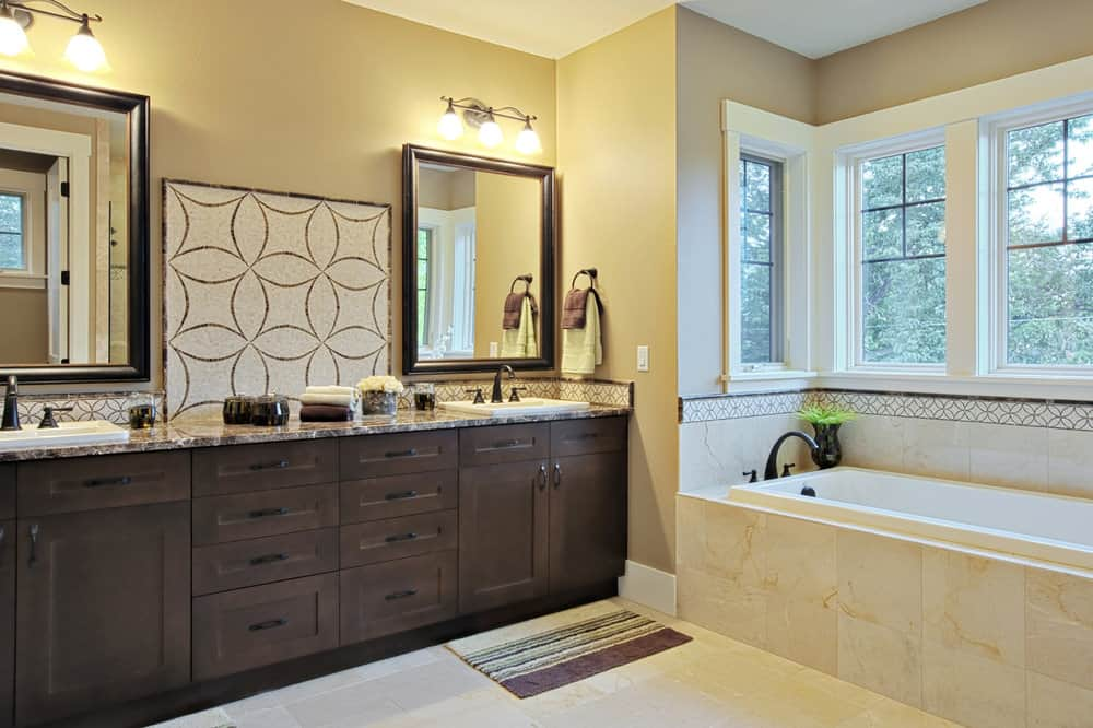 This is an example of a fairly plain alcove tub set into a recessed portion of the bathroom surrounded by windows.
