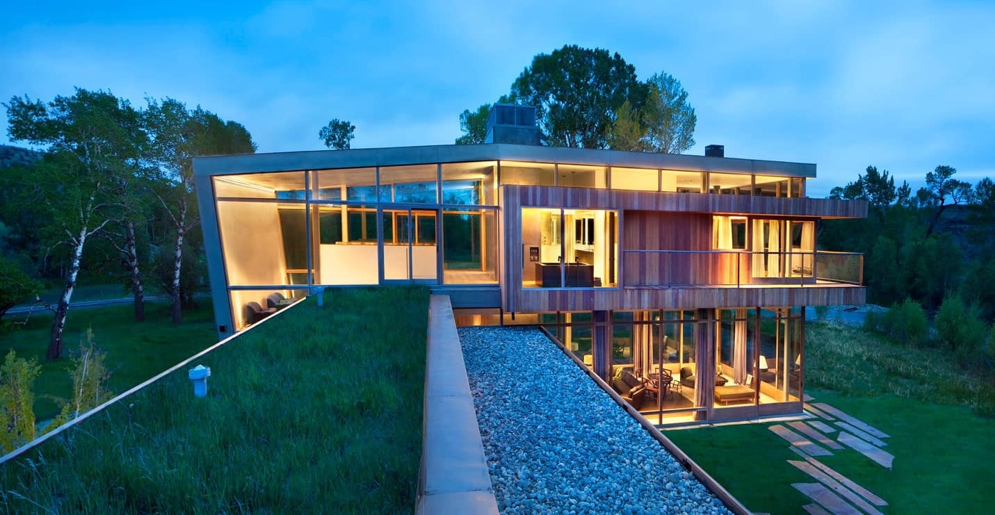 Luscious green lawn, gravel bed and a unique irregular pathway that leads to this magnificent contemporary house.