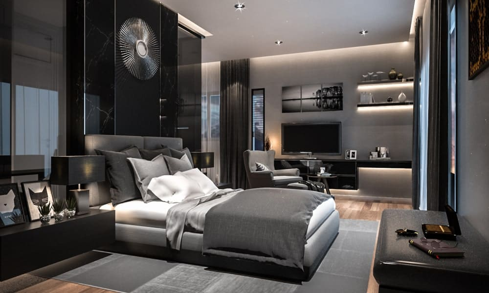 A huge modern bedroom with its own living room, illuminated floating shelves, hardwood floors, and recessed ceiling lights.