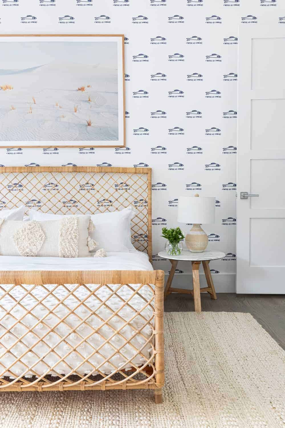 A gorgeous bedroom with a stylish wall design and a fancy bed frame set on the hardwood flooring topped by a large area rug.