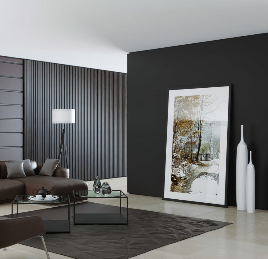 Modern living room accented with striped wall panels and a geometric rug. On the other hand, it is contrasted with white ceiling along with artwork and home decors.