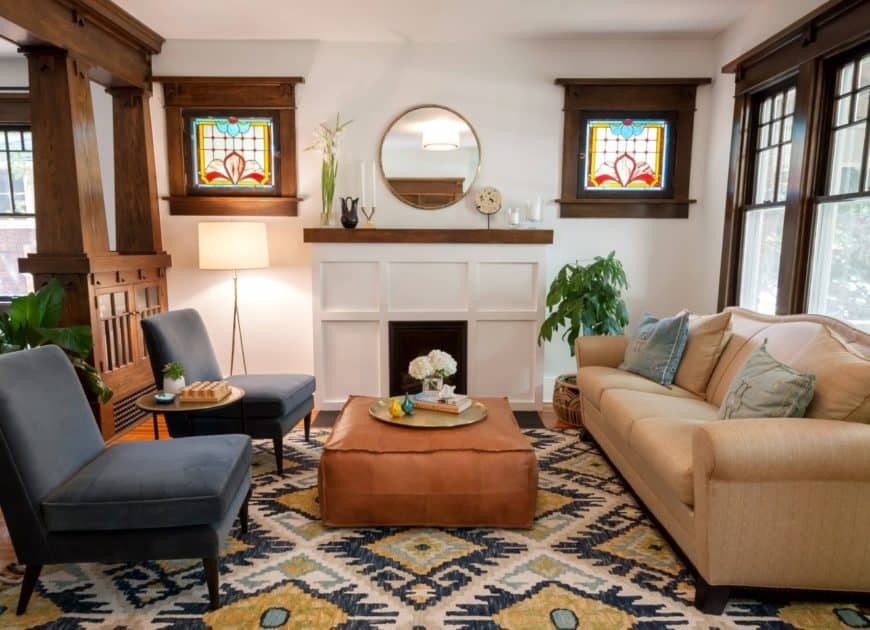 Artsy living room accented with wood elements that match the hardwood flooring and topped by an eye-catching patterned rug. It has a beige sectional contrasted with black upholstered chairs and a square ottoman that serves as the center table.Artsy living room accented with wood elements that match the hardwood flooring and topped by an eye-catching patterned rug. It has a beige sectional contrasted with black upholstered chairs and a square ottoman that serves as the center table.Artsy living room accented with wood elements that match the hardwood flooring and topped by an eye-catching patterned rug. It has a beige sectional contrasted with black upholstered chairs and a square ottoman that serves as the center table.