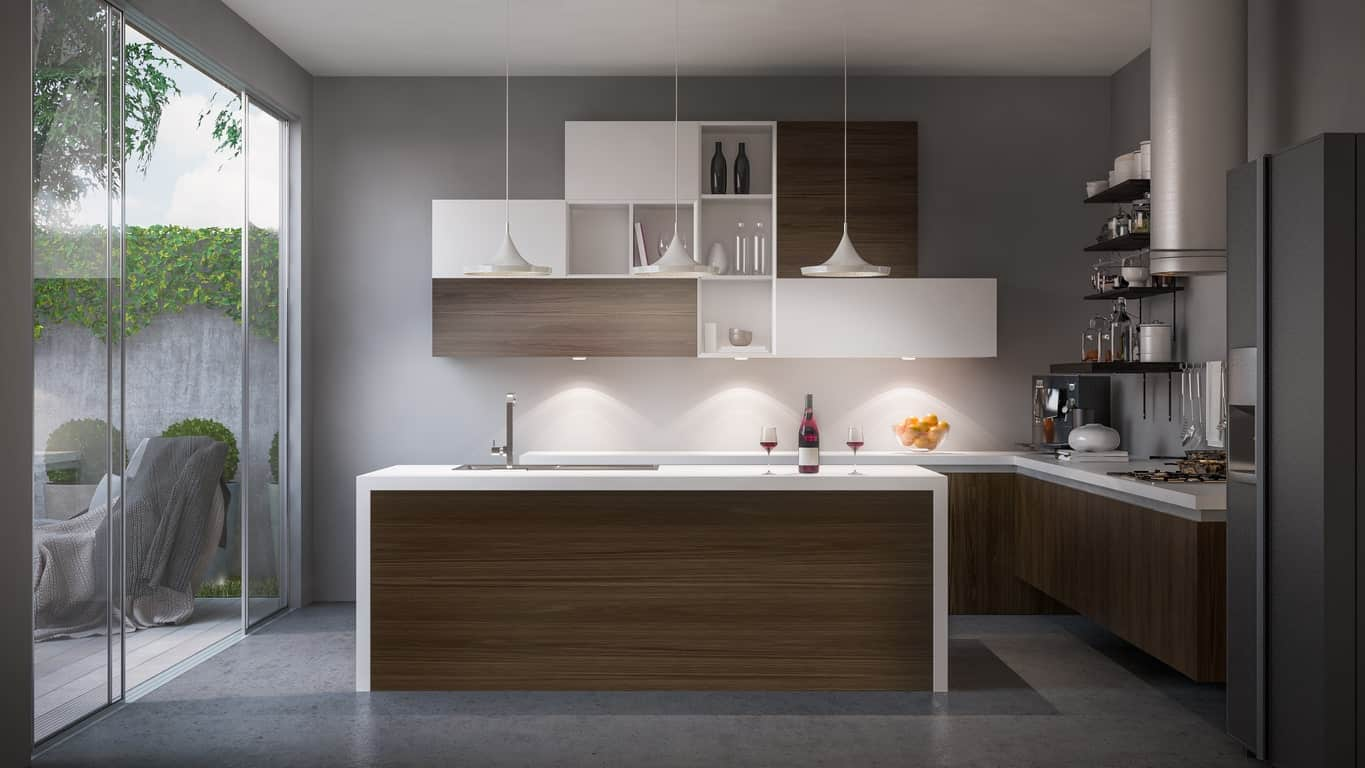 Modern kitchen featuring gray floors and walls, along with a graceful set of pendant lights. There's a doorway leading to the outdoor area as well.
