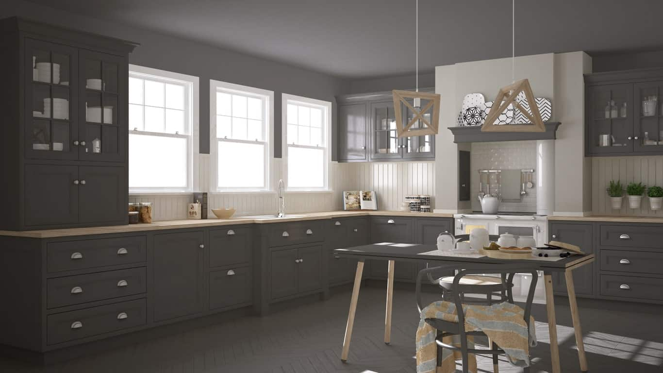 Spacious kitchen featuring gray walls and floors, matching the gray kitchen counters and cabinetry.
