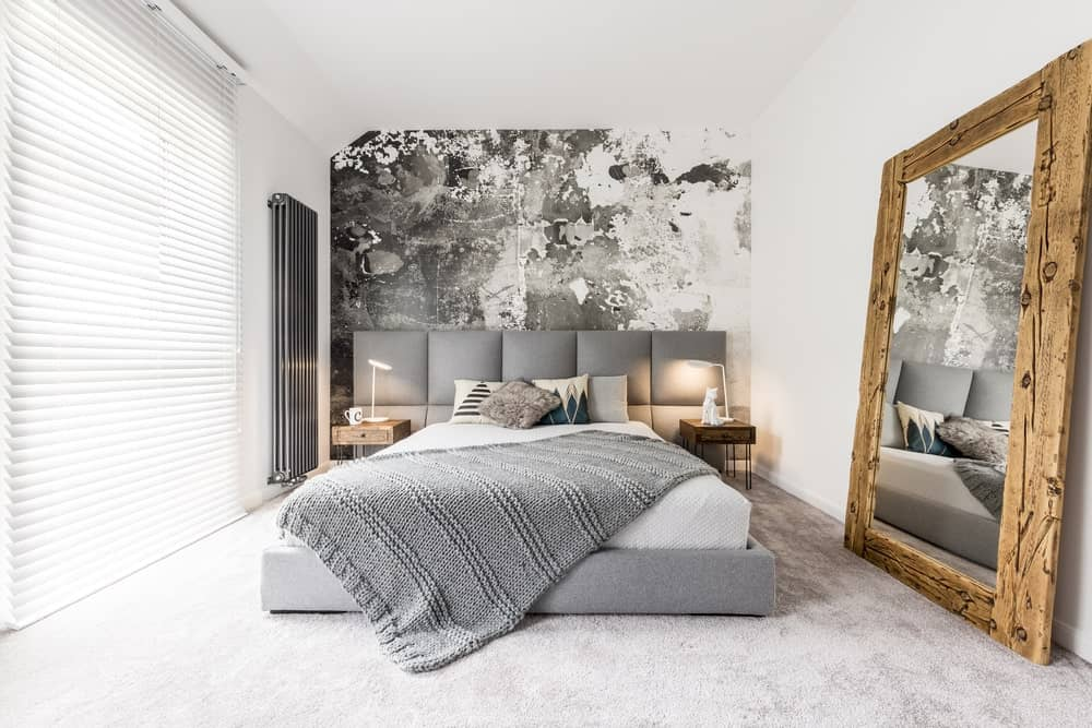 White primary bedroom with a shade of gray. The room features a stunning and very attractive wall and classy carpet flooring.