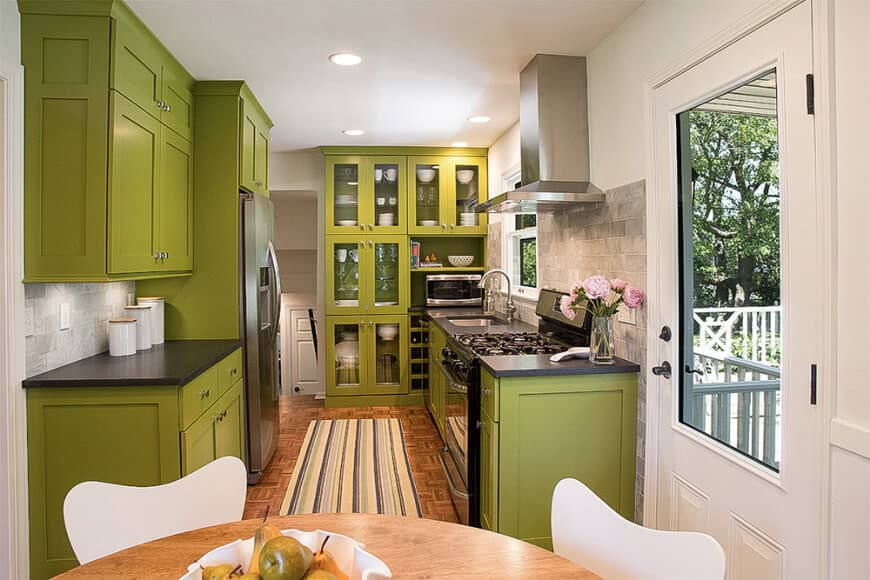 I'm on the fence here. I don't mind the green. I like the kitchen design for the small space. I think there's too much of the green - if the end cabinets were white, it would lessen the overbearing effect of the green.