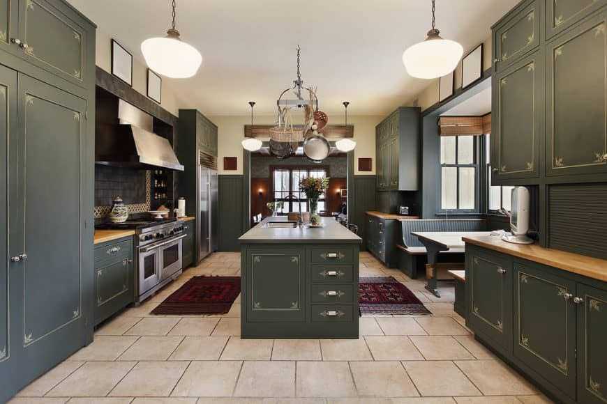 This is probably my favorite green kitchen example in this gallery. I love the British racing green which actually works well as a dominant interior color for cabinets. The inlays stand out nicely and enhance the design. Aside from the color scheme, the size of the kitchen is massive - like a small apartment. It includes a very cool bench dining area. The only thing I don't care about this kitchen is the floor. I'm not big on tile. I believe a mid-tone hardwood would look much better. You?