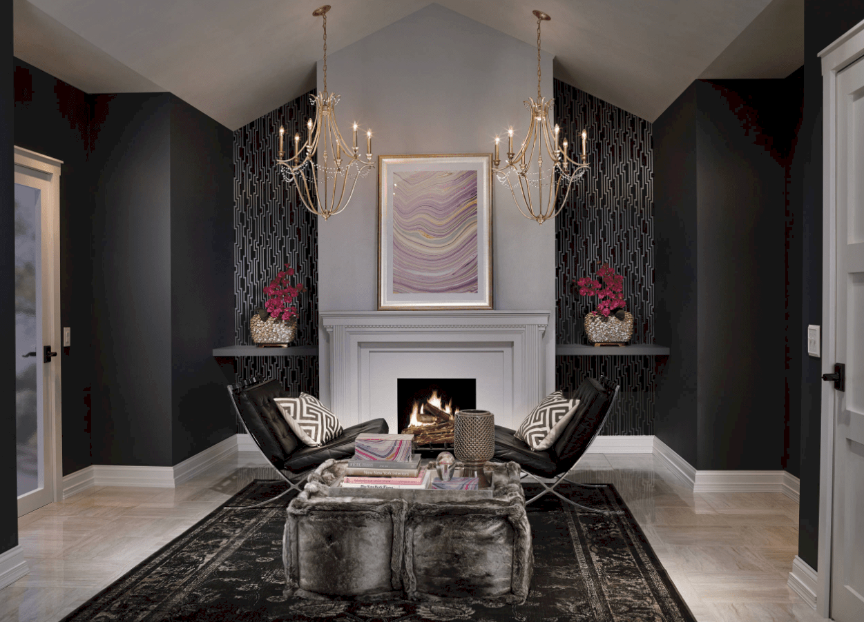 Black living space featuring comfy seats set on a stylish black rug near the fireplace.