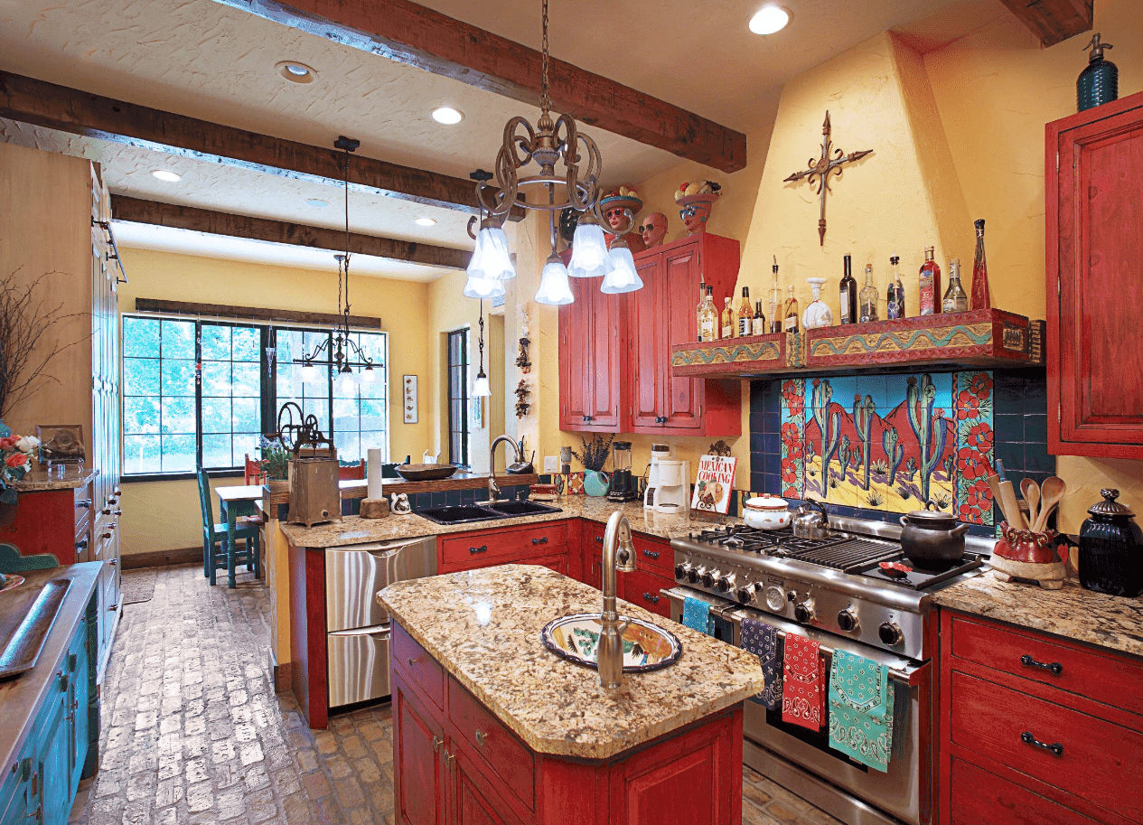 This kitchen features yellow walls beautifully contrasted with red cabinetry. There's also a decorative tile mural backsplash beneath a concrete range hood.