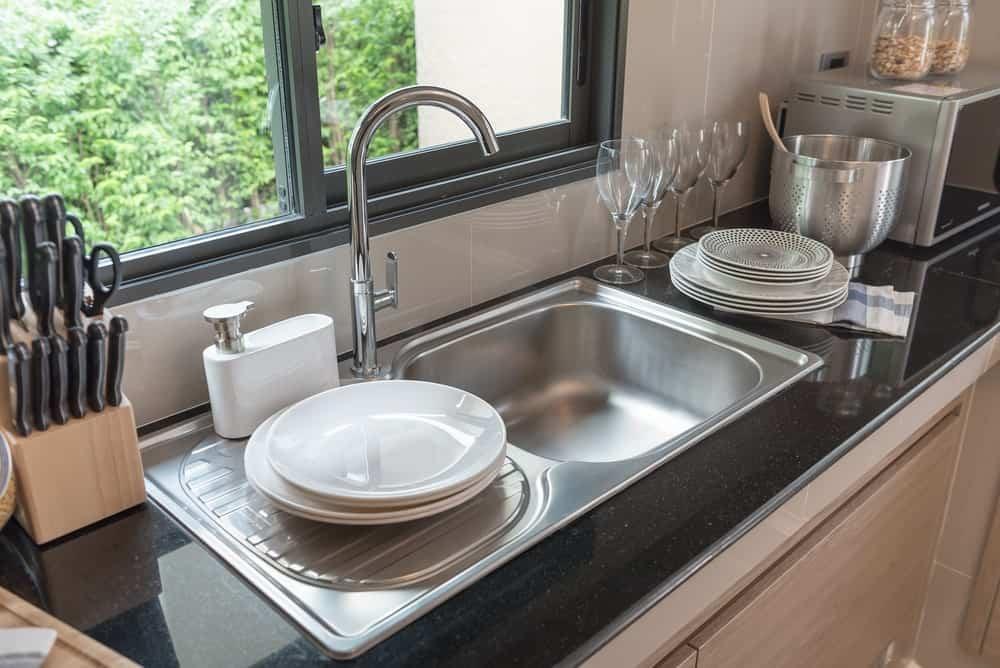 Kitchen sink by the window.