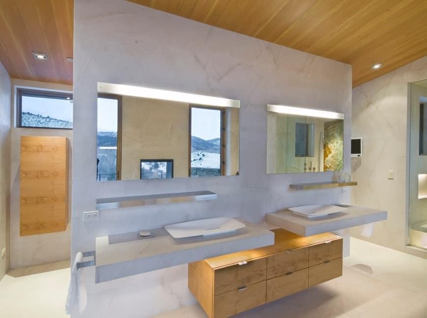 Primary bathroom featuring floating vanities with two vessel sinks.