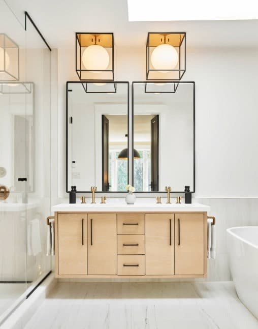 Master bathroom with an elegant double sink, a walk-in shower and a freestanding tub set on the room's stylish flooring.