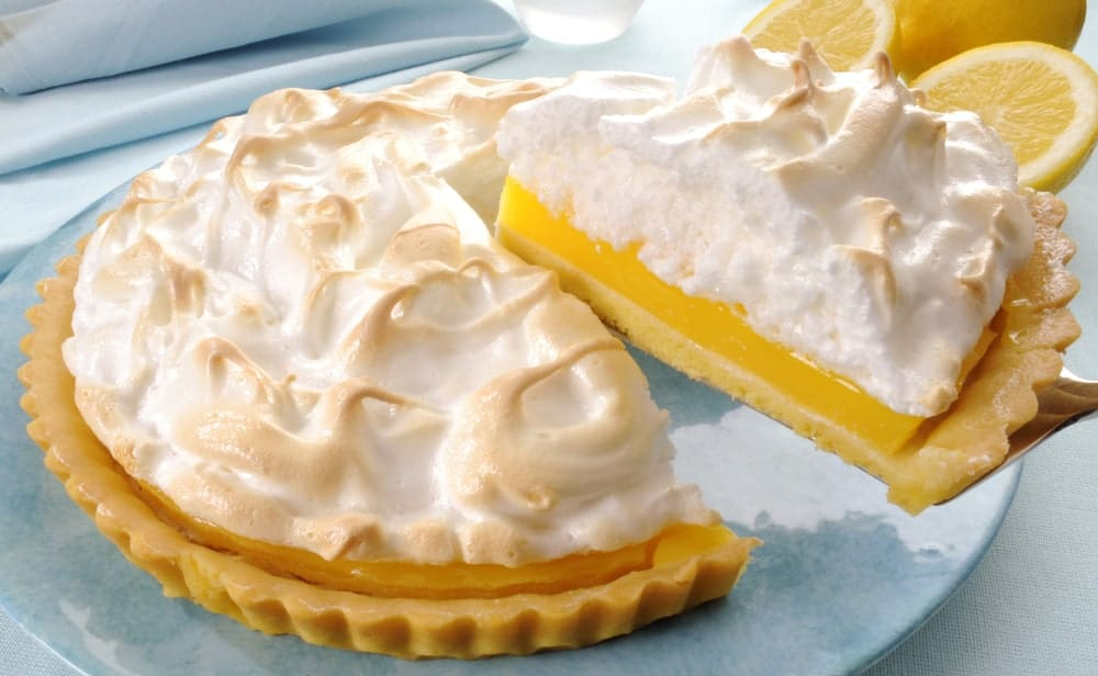 Taking a slice of lemon meringue pie.