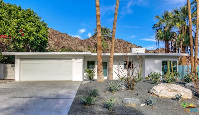 This mid-century house features a desert landscaping at the front yard and a backdrop of the San Jacinto Mountains.