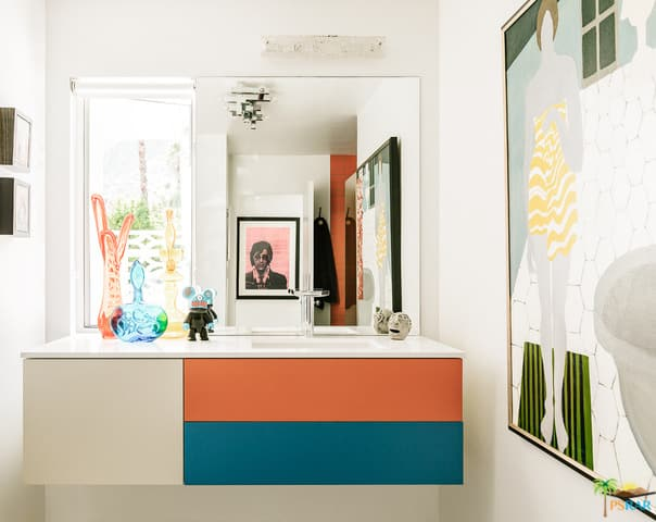 A close up look at this mid-century primary bathroom's lovely floating vanity sink.