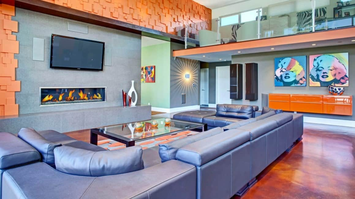 Vast modern living room with purple leather sofa, rectangular glass table, a fireplace, retro-inspired decor, and hardwood floors.