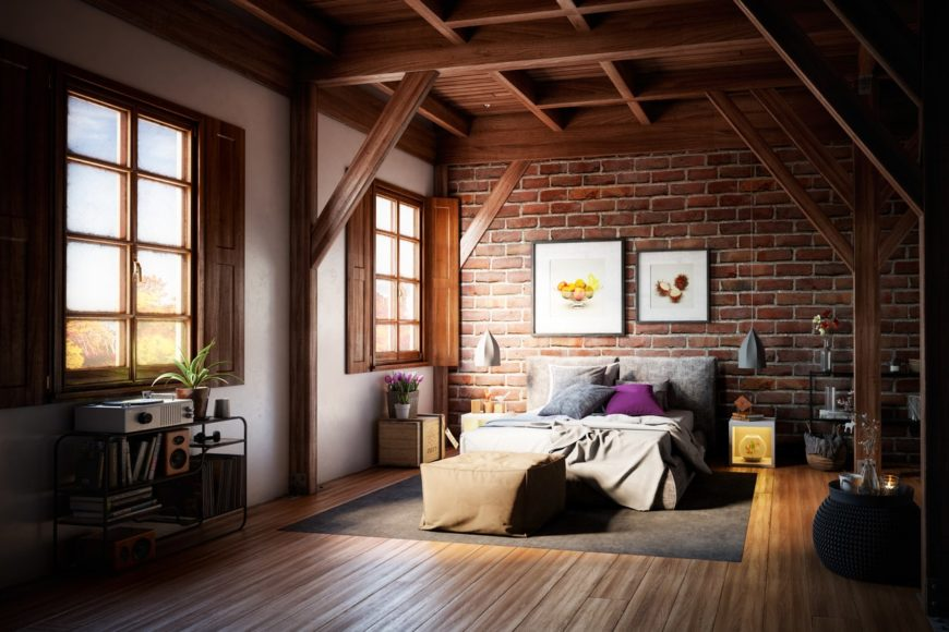 Large master bedroom featuring a rustic brick wall and hardwood flooring, along with wooden ceiling with exposed beams.
