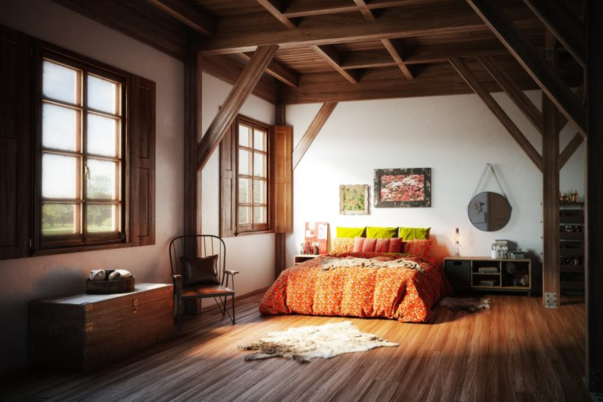 Large master bedroom featuring white walls, hardwood floors, and a wooden ceiling with exposed beams. There are two windows with rustic frames.