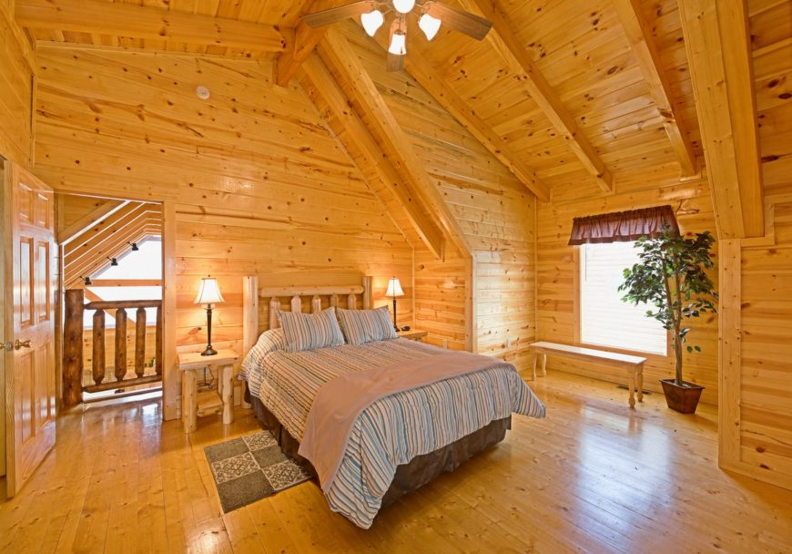 This home offers a master bedroom made of pure woods. It also has a set of rustic furniture.