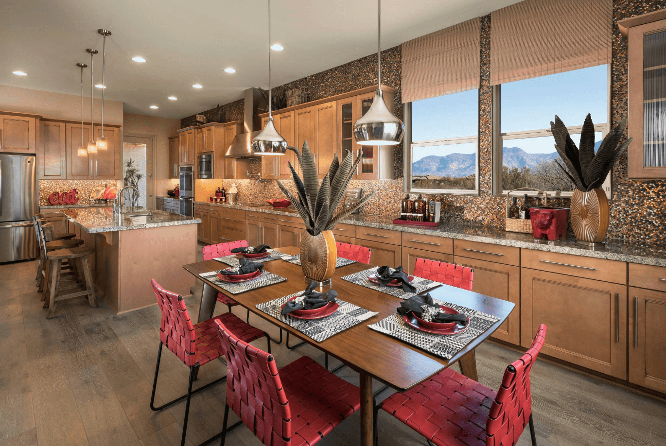 Huge southwestern kitchen with lengthy marble countertop and backsplash that matches the breakfast island. It has glass windows overlooking the spectacular mountain view.