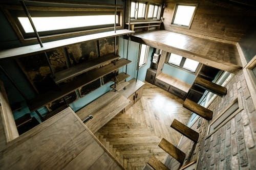 A wooden floating staircase that compliments the look of this tiny industrial house. Its open and sleek design creates a roomy look plus, it's an eye catcher too!