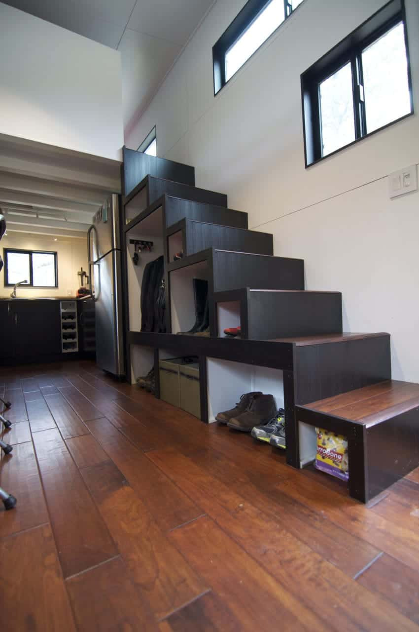 This black and brown staircase offers a great storage solution. It has shelves for your clothes, shoes and other stuff. No closet? No problem!