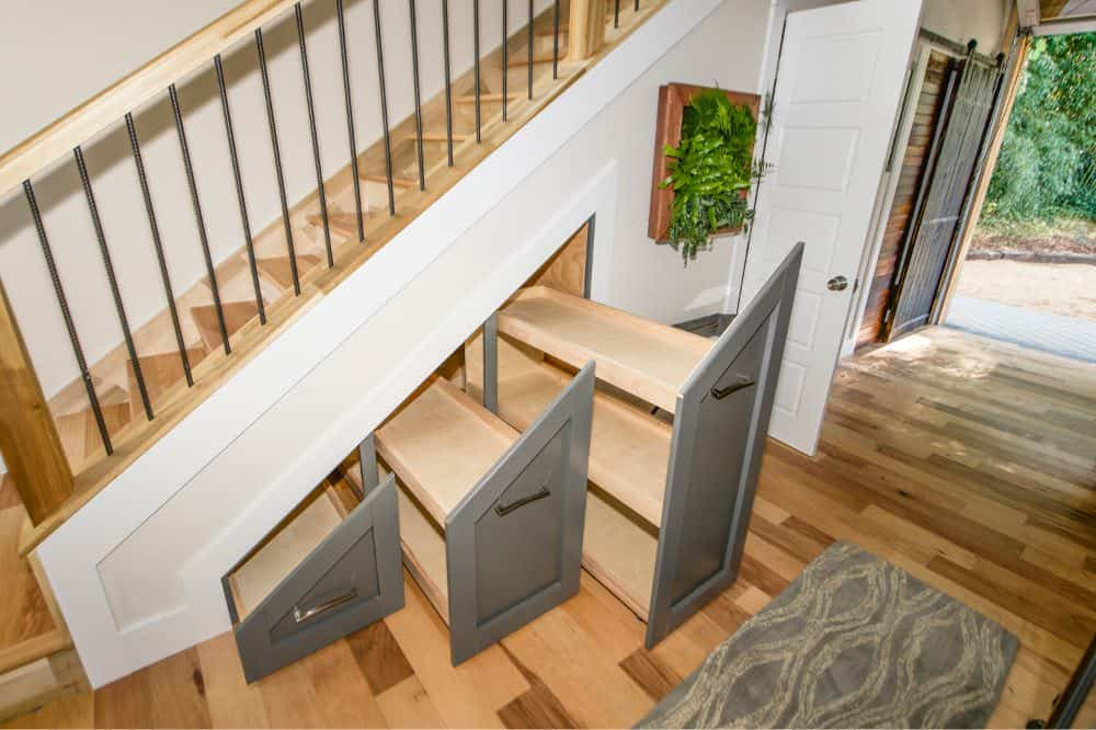 How about growing a plant on a staircase? Yeah, it was made possible by Wind River. This wooden staircase has a rebar railing spindles and a custom polygon storage for your shoes.