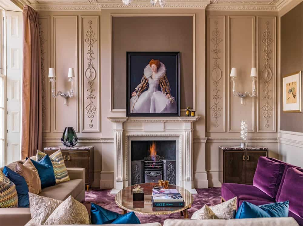 Charming living room decorated with a lovely Victorian portrait mounted on the full wainscoted walls and illuminated by sconces.