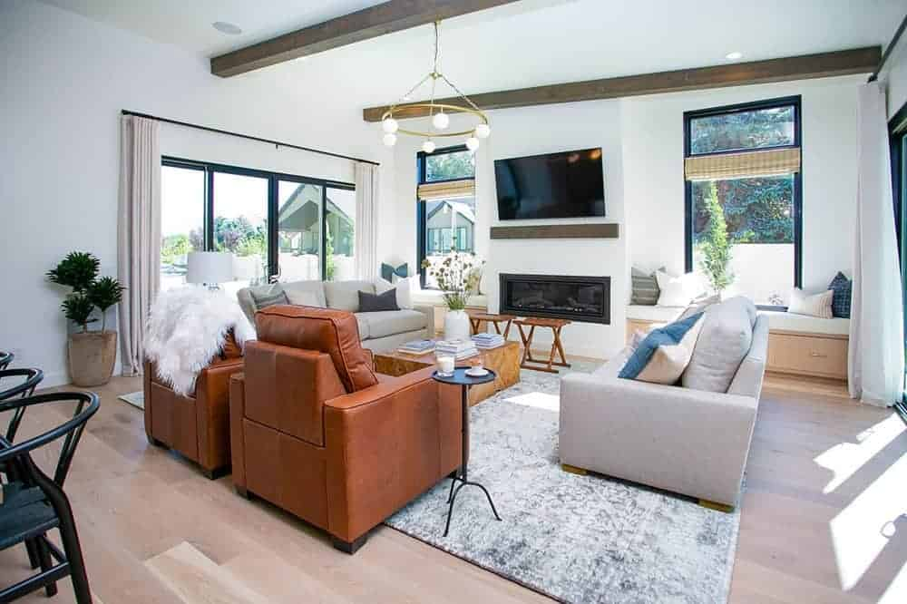 A combination of leather and fabric sofas and chairs create interest in this white contemporary living room.