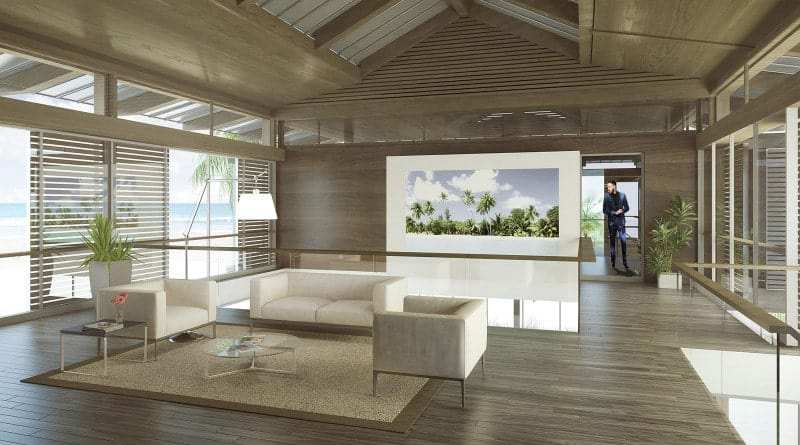An all wood living room boasts a panoramic window that overlooks the stunning beach view. It includes a beige modern sofa set and metal coffee and side table.