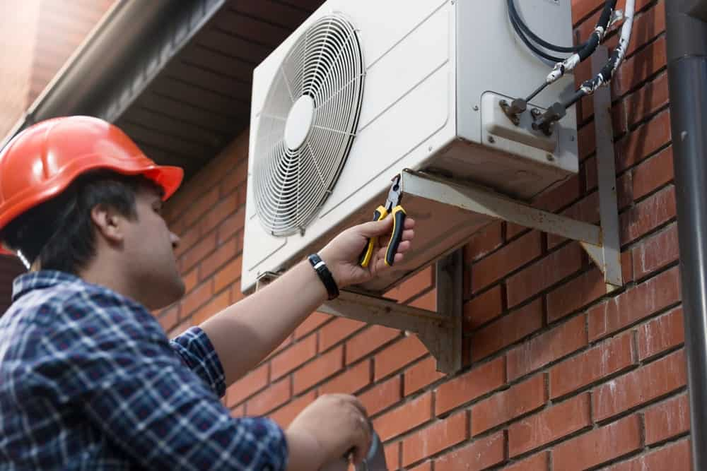 An Air Conditioner Technician at Work