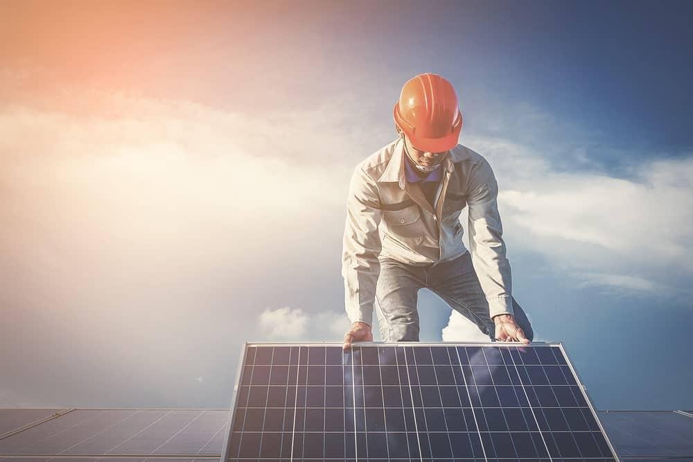 An electrician repairing a solar