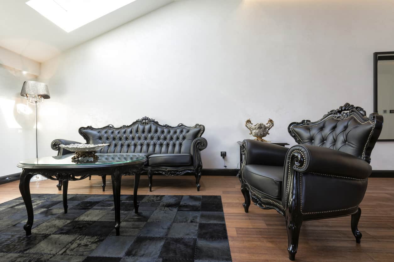 Antique sofa and armchair in living room