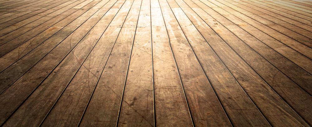 Dark wood floor with sun shining on it