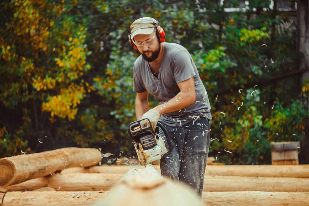 Man using a chain saw